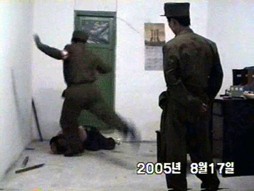 north korean women soldiers. A soldier kicks