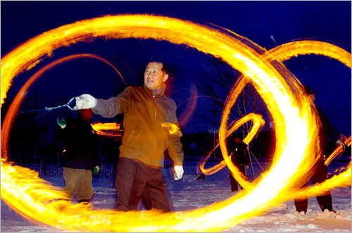 In celebration of Daeboreum, the first full moon of the lunar year, residents of Hampyeong, South Jeolla Province play jwibul-nori, a traditional game spinning a tin with a fire inside.