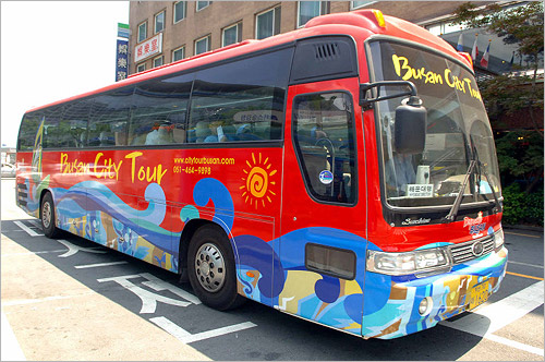 A Busan city tour bus is equipped with a state-of-the-art ubiquitous IT system including RFID (radio frequency identification), wireless Internet and touch screens.