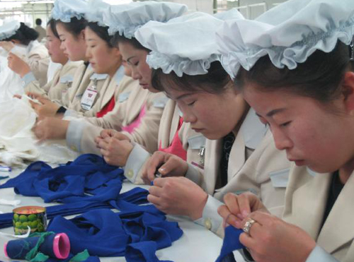 North Koreans work in South Korean apparel company Shinwons factory in the Kaesong Industrial Complex.