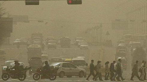 In this file photo, dust obscures a road in Yeouido, Seoul on March 21, 2002, when a severe sandstorm originating from China blanketed the country. 