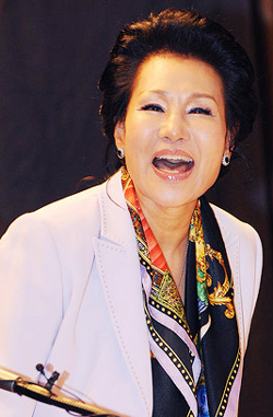 Singer Patti Kim smiles at a press conference to announce a concert to mark the 50th anniversary of her singing debut, at a hotel in Seoul on Monday. /Newsis