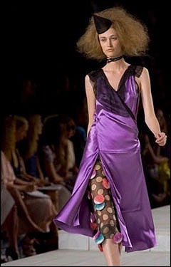 A model showcases a purple dress by Marc Jacobs.