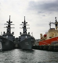 Japan Maritime Self-Defense Force ships drop anchors at pier at base in Yokosuka, Japan, Mar. 28, 2009. 