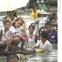 Local residents make their way through floodwaters in Taytay township, Rizal province east of Manila, Philippines on Oct. 3, 2009.