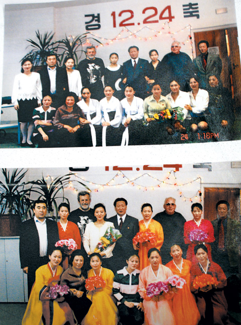 North Korean workers pose for a group photo on Christmas eve in 2004 or 2005 at sewing factory Snezka in the Czech Republic. /Courtesy of Snezka