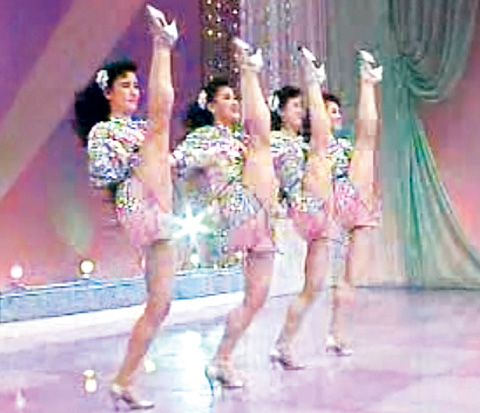 North Korean dancers with the Wangjaesan Light Music Band perform wearing skimpy clothes in this grab from an undated video clip. The band performs at secret parties held by high-ranking officials. /Yonhap