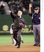 Former President George Bush throws out the ceremonial 1st pitch at start of Game 3 of the Japan Series baseball in Tokyo on Nov. 3, 2009.