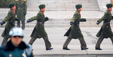 North Korean soldiers take part in the repatriation ceremony for a North Korean army sergeant at the truce village of Panmunjom on Wednesday. The North Korean officer was plucked from a small boat that drifted last Sunday into South Korean waters off the west coast.