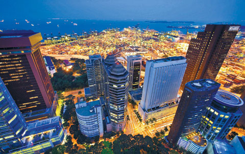 Office buildings, including CapitaLand and HSBC Holdings, stand in the central business district of Singapore. /Bloomberg