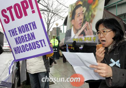 A protestor in Seoul calls for the release of Robert Park, an evangelical activist who crossed the frozen border river into North Korea.