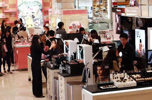 People shop at a department store in Seoul.