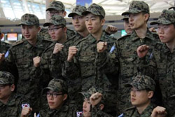 Korean army soldiers pose before leaving for Haiti at the Incheon International Airport on Wednesday. /VOA