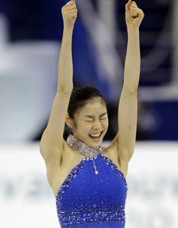 Kim Yu-na reacts after finishing the ladies free skating at the Vancouver Olympics on Friday. /Yonhap