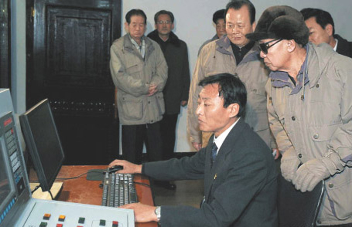 In this undated photo released by the Norths officials Korean Central News Agency on Dec. 9, 2009, North Korean leader Kim Jong-il inspects the Kanggye General Tractor Plant No. 26 in Jagang Province.