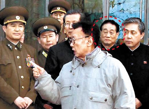 North Korean leader Kim Jong-il (center), accompanied by senior officials including the Workers Partys Finance Director Pak Nam-gi (second from right), visits a new swimming pool at Kim Il-sung University in March last year. /[North] Korean Central News Agency-Yonhap