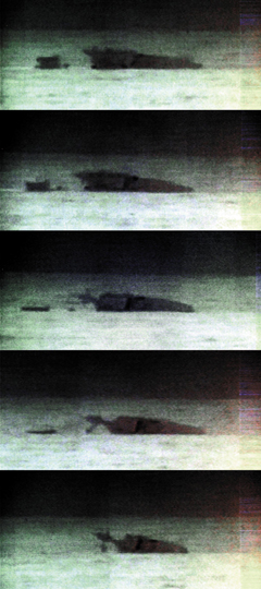 In these grabs from a night-vision video clip released by the Defense Ministry on Wednesday, the stern of the corvette Cheonan on the left is sinking fast compared to the slowly sinking bow on the right. /Courtesy of the Korean Navy