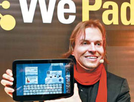 Managing director of IT firm Neofonie Helmut Hoffer von Ankershoffen holds the WePad tablet computer during its presentation in Berlin on Sunday. /Reuters