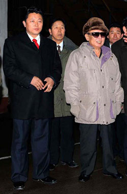 The Mainichi Shimbun released this photo on Tuesday claiming the young man standing beside North Korean leader Kim Jong-il is his third son and heir apparent Kim Jong-un. /Yonhap