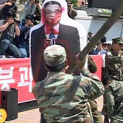 South Korean protesters in Seoul club an inflatable effigy of North Koreas Kim Il-sung on May 27, 2010.