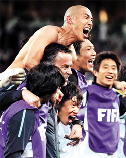 The Korean national squad celebrates advancing to the round of 16 after the Group B match against Nigeria in the World Cup on Wednesday. /AFP