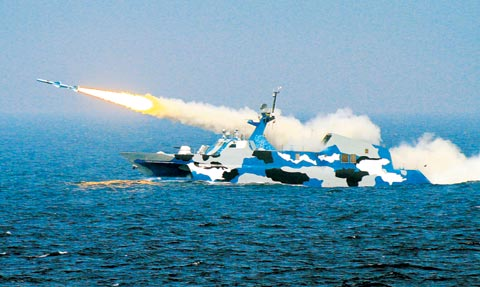 A Chinese Navy ship fires a  missile during a live fire exercise in the East China Sea early this  month. /Xinhua-Yonhap