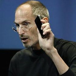 Apple CEO Steve Jobs holds up iPhone 4 as he talks about the Apple iPhone 4 at Apple headquarters in Cupertino, California on July 16, 2010. /AP