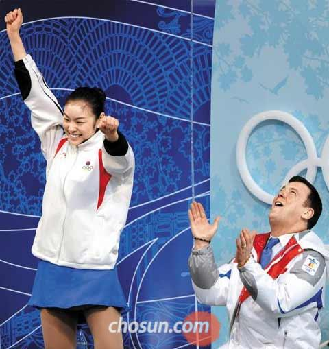 Kim Yu-na and coach Brian Orser react to her scores at the 2010 Vancouver Olympics.