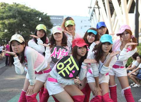 Japanese fans in similar attire as the Girls Generation pose for a photo.