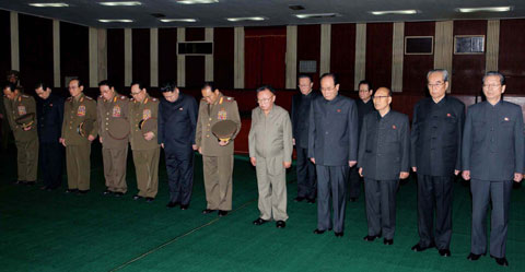 North Korean leader Kim Jong-il and his son and heir Jong-un along with senior officials on Monday pay tribute to Jo Myong-rok, the first vice chairman of the top policy-making National Defense Commission, who died Saturday. /[North] Korean Central News Agency-Yonhap