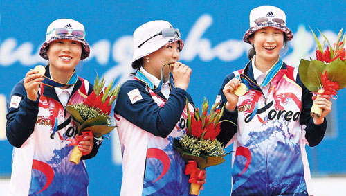 The Korean womens archery team celebrates after winning the team event at the Guangzhou Asian Games on Sunday.
