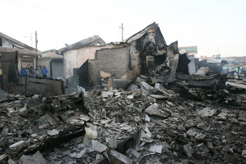 A village on Yeonpyeong Island has been reduced to rubble by North Korean artillery on Tuesday. /Newsis