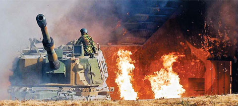 A K-9 Marine artillery base on Yeonpyeong Island under attack by North Korea on Tuesday /Courtesy of the Ministry of Defense