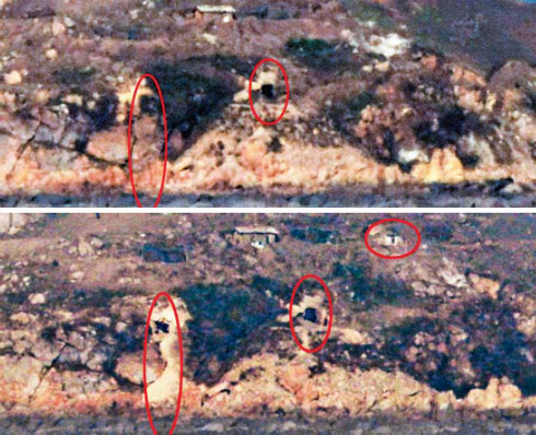 A photo taken from Yeonpyeong Island on Thursday (bottom) reveals a newly built guard post and road near the Kaemori artillery base in Kangryong, South Hwanghae Province in North Korea that are not seen in a photo of the base taken in November last year (top).