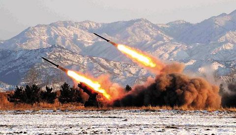 North Koreas Artillery Command Unit 1489 stages a drill. Leader Kim Jong-il and his son and heir Jong-un reportedly visited the unit in an unknown location early last year. /[North] Korean Central News Agency-Yonhap