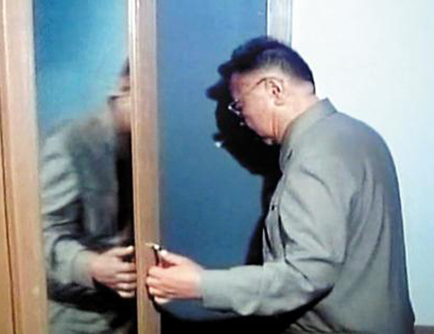 North Korean leader Kim Jong-il opens a closet door with his left hand in this footage broadcast by [North] Korean Central TV on Wednesday. /KCTV-Yonhap