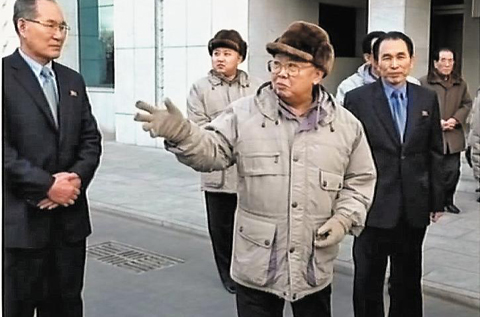 North Korean leader Kim Jong-il and his son and heir Jong-un wear Russian-style furry hats during a visit to the Mansudae Art Studio in Pyongyang, in this screen grab released Jan. 23 by [North] Korean Central TV. /KCTV-Yonhap