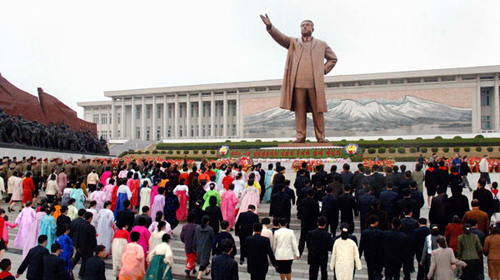 North Koreans pay homage to the statue of former leader Kim Il-sung in front of the Mansudae Assembly Hall in Pyongyang to mark his birthday in 2009.
