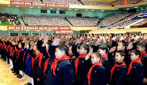Students celebrate the 67th birthday of North Korean leader Kim Jong-il in 2009.