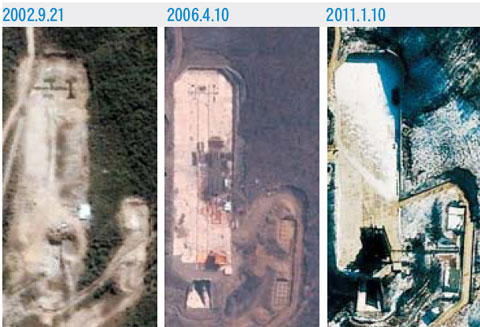 Satellite photos taken since 2002 show progress at what is believed to be an intercontinental ballistic missile test site in Tongchang-ri, North Pyongan Province. /From the website of Global Security