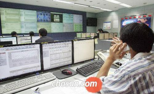 Staff monitor traffic flow at the Korea Internet and Security Agency in Seoul on July 8, 2009.