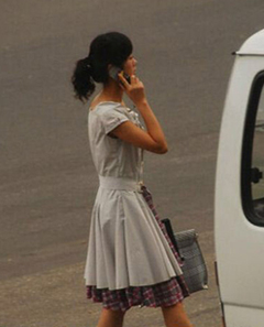 This screen grab from a program shown on Free North Korea Radio shows a North Korean woman using a cell phone in Pyongyang. /Free North Korea Radio