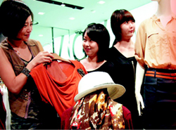 Tourists shop at a clothing store in Seoul.