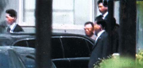 North Korean leader Kim Jong-il leaves a facility in Changchun on Saturday. /Asahi TV