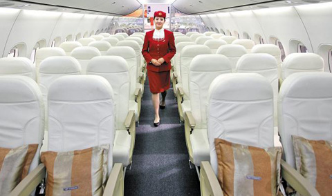 A stewardess poses in Comacs C919 passenger jet at the Paris air show on June 21. /Bloomberg
