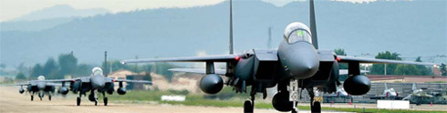 F-15K fighter jets land at an airbase in Deagu.