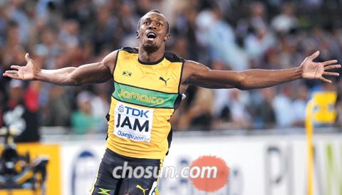 Usain Bolt of Jamaica reacts after setting a new world record in the mens 400-m relay at the IAAF World Athletics Championships in Daegu on Sunday.