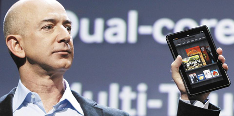Amazon CEO Jeff Bezos holds up the new Kindle Fire at a news conference during the launch of Amazons new tablets in New York, on Wednesday. /Reuters-Newsis