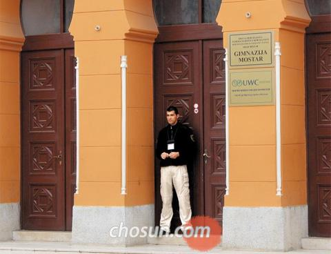 A security guard stands in front of the United World College in Mostar, Bosnia on Thursday.