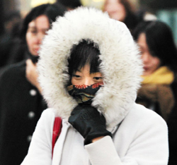 A woman wraps up warm against the cold in Seoul on Wednesday.